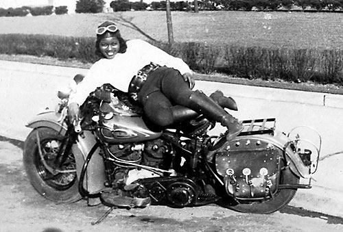 Bessie Stringfield, an African-American women motorcycle rider, relaxing on her Harley Davidson